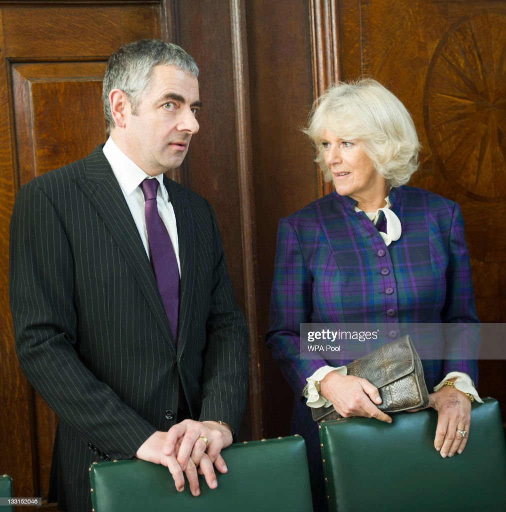 Camilla, Duchess of Cornwall meets former student actor Rowan Atkinson as she opens the new Shulman Auditorium at The Queen's college on November 17, 2011 in Oxford, England.