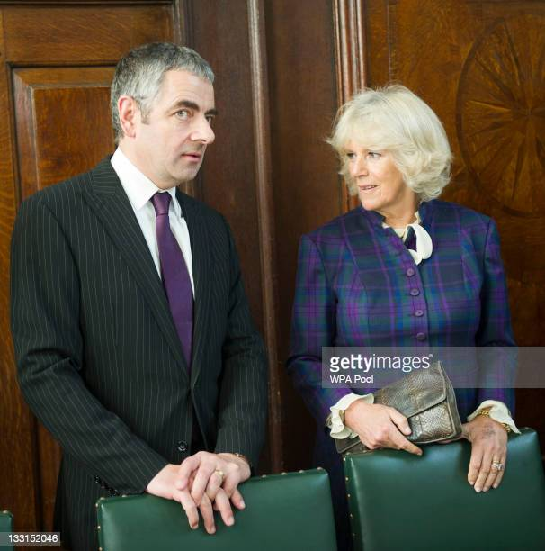 Camilla Duchess of Cornwall meets former student actor Rowan Atkinson as she opens the new Shulman Auditorium at The Queen's college on November 17...