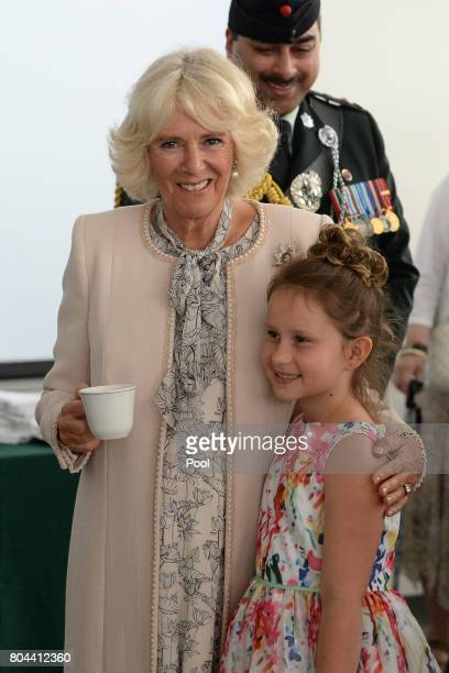 Camilla Duchess of Cornwall meets Georgia Pampe whose father is a part of the Queen's Own Rifles of Canada at Canadian Forces Base Trenton during a 3...