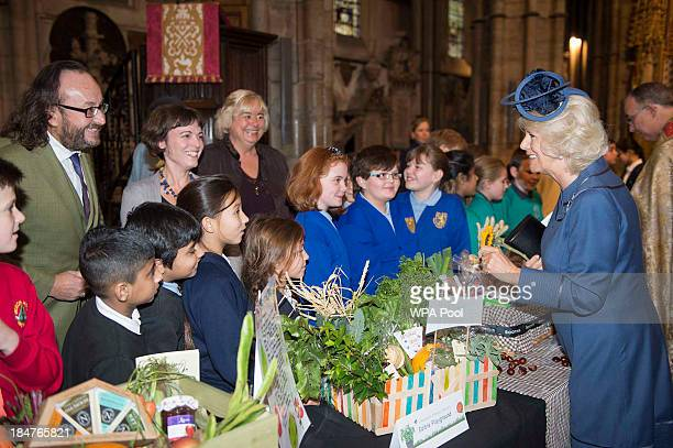 Camilla Duchess of Cornwall meets Hairy Biker Dave Myers and children with their Harvest offerings as they attend the British Food Fortnight's...