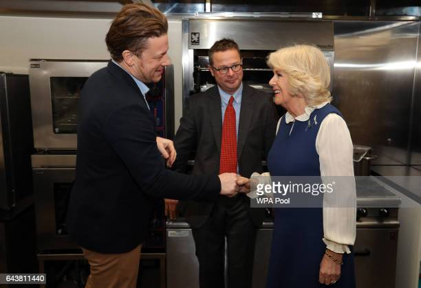 Camilla Duchess of Cornwall meets Jamie Oliver and Hugh FearnleyWhittingstall in the kitchen during a reception to launch The Great Get Together at...