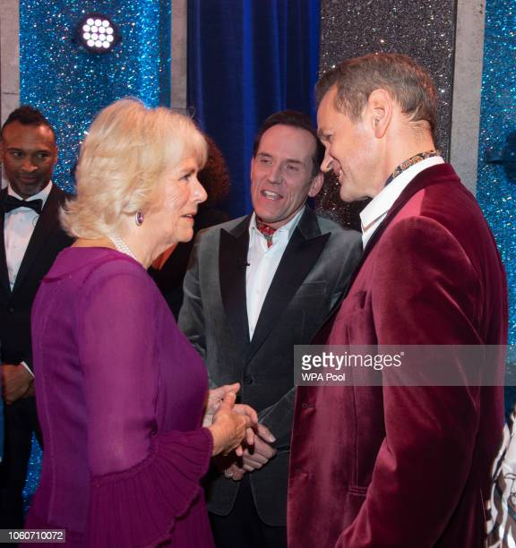 Camilla Duchess of Cornwall meets meets cast members Ben Miller and Alexander Armstrong after attending a one off performance of 'We Are Most Amused...