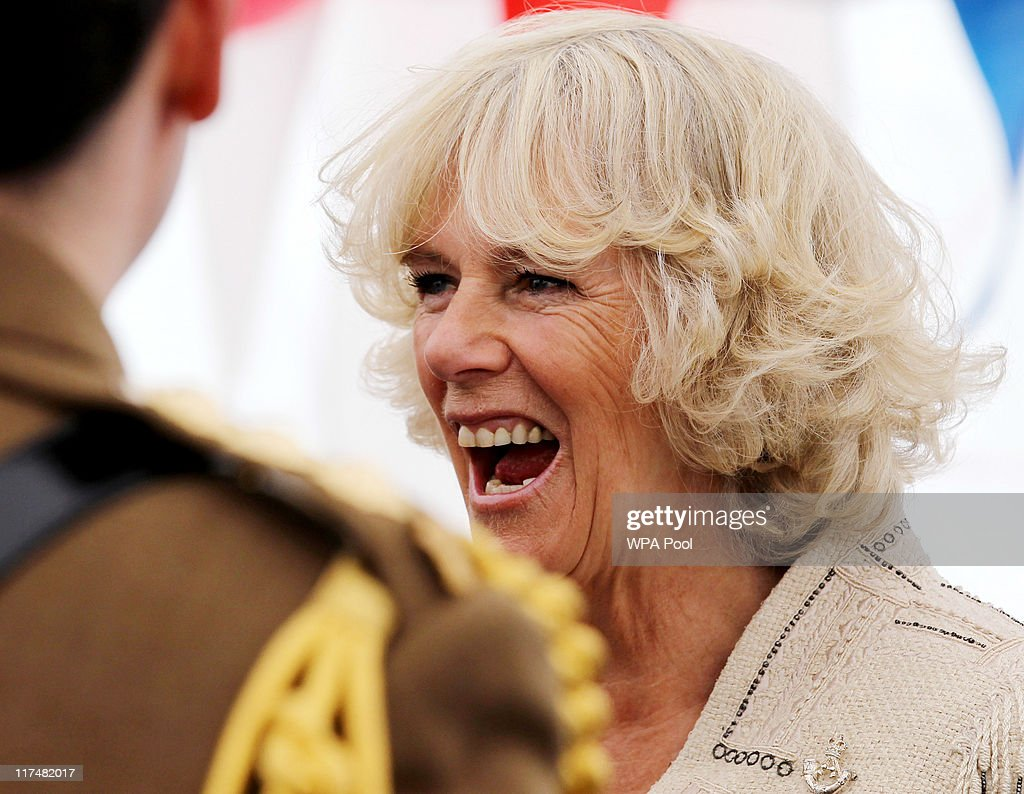 Camilla, Duchess of Cornwall meets members of the DecAid team after watching the DecAid Massed Pipe and Drum Parade from a dais in front of the Scottish Parliament in Holyrood Park on June 26, 2011 in Edinburgh, Scotland.