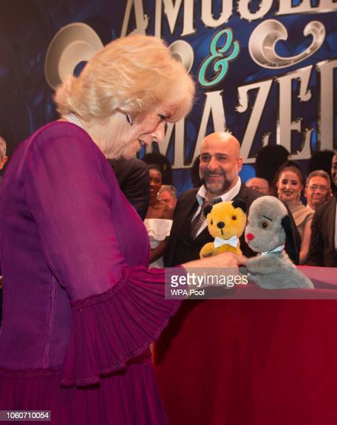 Camilla Duchess of Cornwall meets Omid Djalili and puppets Sooty and Sweep after attending a one off performance of 'We Are Most Amused and Amazed'...