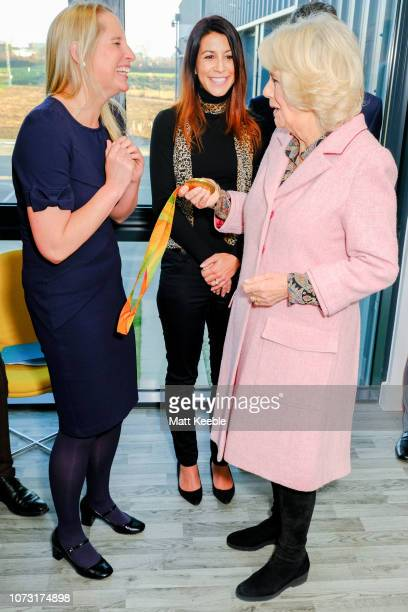 Camilla Duchess Of Cornwall meets Paralympic gold medalist Stephanie Millward during a visit to Wiltshire Air Ambulance's airbase at Outmarsh on...