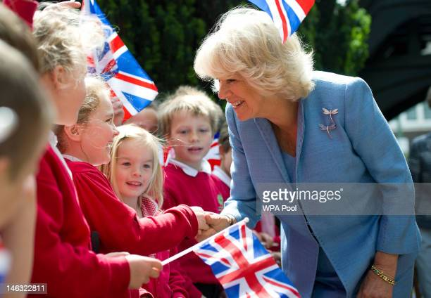 Camilla, Duchess of Cornwall meets pupils from Barnes Primary School during her visit to a flower festival celebrating Queen Elizabeth II's Diamond...