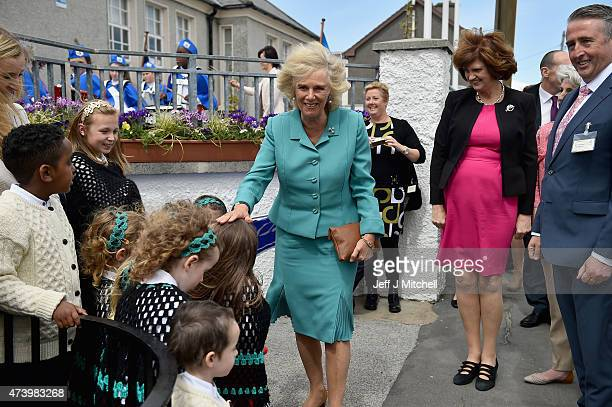 Camilla Duchess of Cornwall meets school children during a visit to the Claddagh National School on May 19 2015 in Ireland Galway The Prince of Wales...