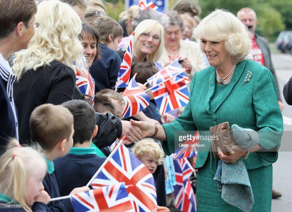 Camilla, Duchess of Cornwall meets staff and pupils at Ysgol Penmaes, a specialist school for children with learning difficulties, on day two of the royal couple's annual tour of Wales on July 10, 2012 in Brecon, United Kingdom. Prince Charles, Prince of Wales and Camilla, Duchess of Cornwall are on their annual tour of Wales.