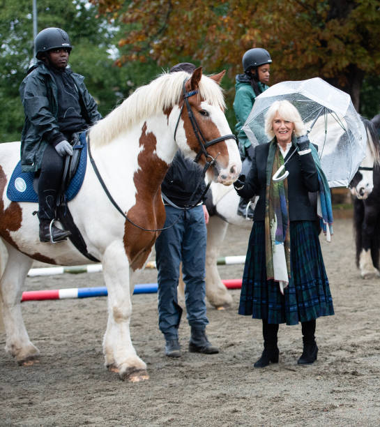 GBR: The Duchess Of Cornwall Visits Horse Club And Boxing Club
