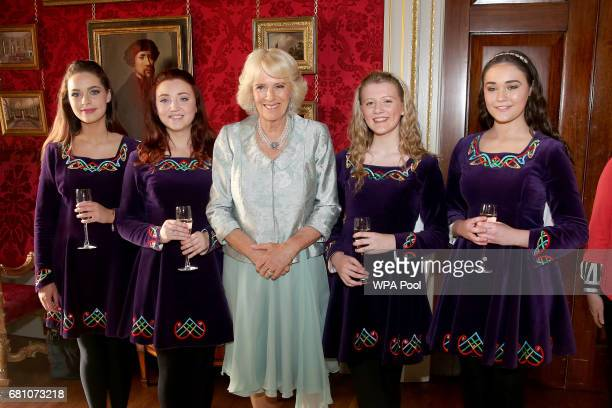 Camilla Duchess of Cornwall meets the Tir na NOg Irish Dancers Sarah White Rose McAuley Zoe McGarry and Naomi Brown at a Music Words for a Spring...