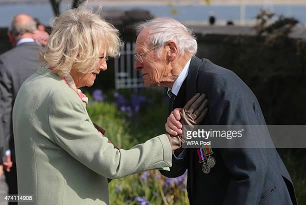 Camilla Duchess of Cornwall meets Tobruk veteran Robert Edmond Howarth aged 94 during a visit to the peace garden on May 20 2015 in Sligo Ireland The...