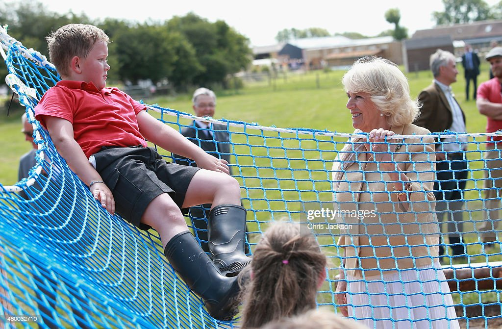 Camilla, Duchess of Cornwall meets young children in the adventure playground as she visits Humble by Nature Farm on July 9 2015 in Monmouth, Wales. Humble by Nature is a working farm which was saved from closure by Kate Humble and her husband Ludo Graham in 2010. It includes a rural skills centre as well as a farm shop, cafe and adventure playground.