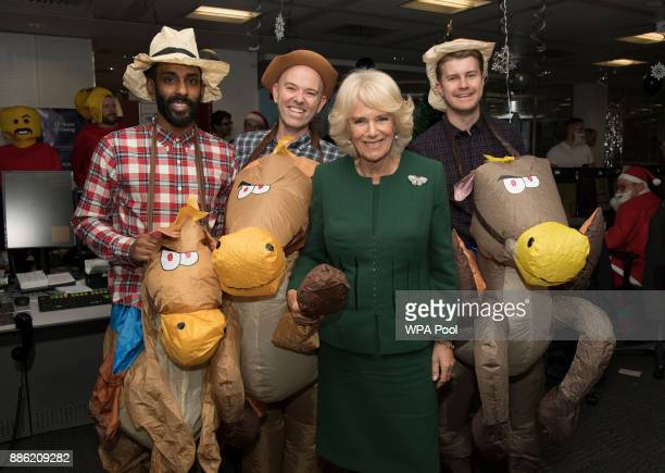 Camilla, Duchess of Cornwall, Patron, Medical Detection Dogs, meets staff and charity representatives during her visit to ICAP during the broker's...
