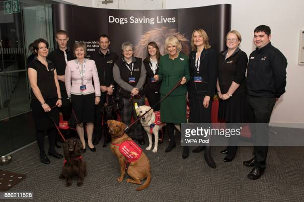 Camilla Duchess of Cornwall Patron Medical Detection Dogs meets staff and charity representatives during her visit to ICAP during the broker's annual...