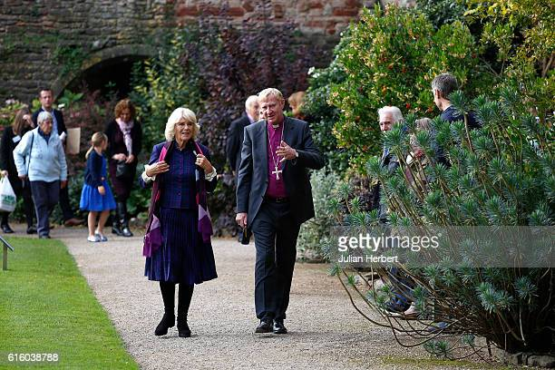 Camilla Duchess of Cornwall patron of Beanstalk is shown around The Bishops Palace Gardens byThe Rt Revd Peter Hancock Bishop of Bath and Wells as...
