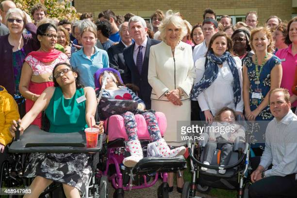 Camilla Duchess of Cornwall Patron of Helen Douglas House Hospice poses for a photo with patients staff and family members as she visits Douglas...