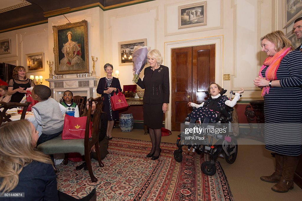 Camilla, Duchess of Cornwall, patron of the Helen & Douglas House and The London Taxidrivers' Fund invites underprivileged children from both charities to decorate the Christmas tree and join the Duchess for Christmas lunch at Clarence House on December 15, 2015 in London, England.