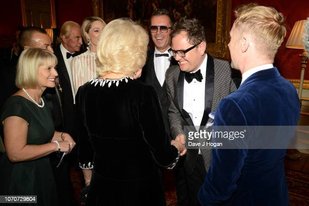 Camilla, Duchess of Cornwall, Paul Drayton, Alan Carr and Ronan Keating attend the Julien Macdonald Fashion Show for National Osteoporosis Society at...
