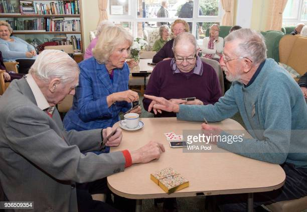 Camilla Duchess of Cornwall plays the card game 'Rummy' with residents as she visits The Fair Close Centre on March 22 2018 in Newbury England The...