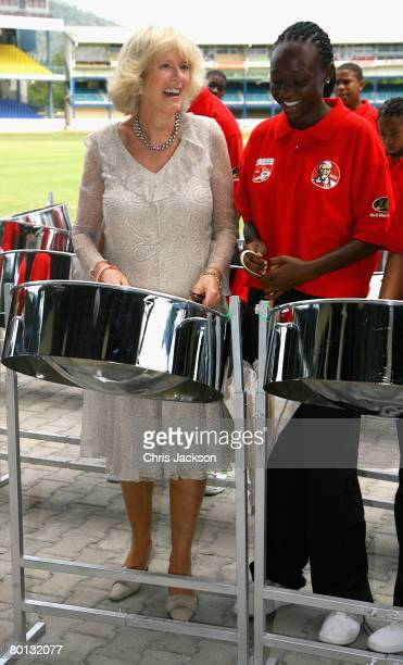 Camilla, Duchess of Cornwall plays the steel pan at Queen's Park cricket ground on the second day of a three day tour of Trinidad and Tobago on March...