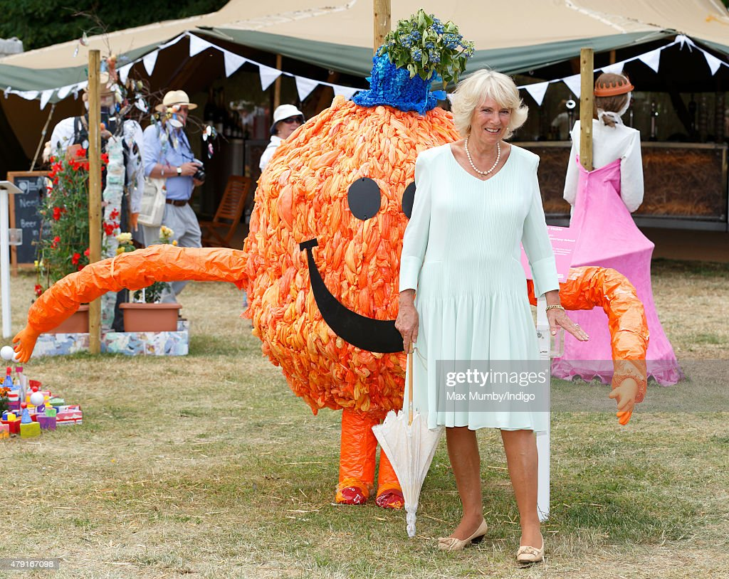 Camilla, Duchess of Cornwall poses alongside a Mr Men character 'Mr Tickle' scarecrow as she attends The Hampton Court Flower Show at Hampton Court Palace on July 1, 2015 in London, England.