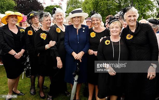 Camilla Duchess of Cornwall poses for a photo with the Calendar Girls Moyra Livesey Beryl Bamforth Christine Clancy Lynda Logan Duchess Angela Baker...