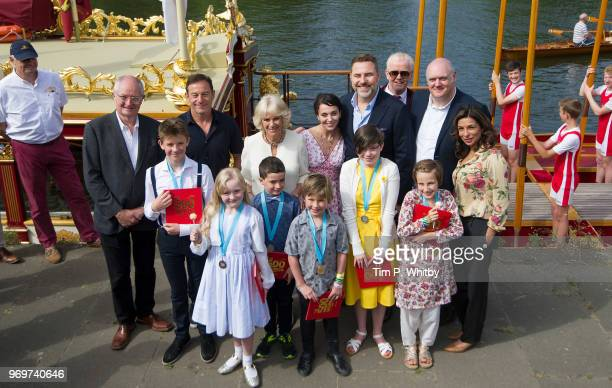 Camilla Duchess of Cornwall poses for a photograph alonside Gloriana the Queens Rowbarge with celebrities including Jim Broadbent Jason Issacs Amanda...