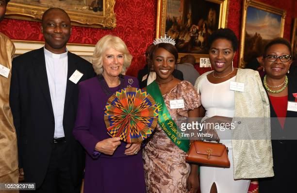 Camilla Duchess of Cornwall poses for a photograph with Mark Odion Miss Nigeria UK Adedoyin George and Ganyiat Adeshola Oluwfunke Alli at a reception...