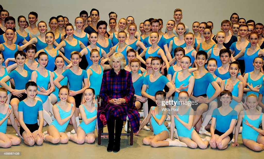 Camilla, Duchess of Cornwall poses for a photograph with students during a tour of Elmhurst School of Dance on November 25, 2014 in Birmingham, England.