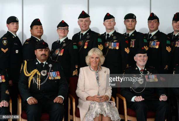 Camilla Duchess of Cornwall poses for a photograph with the Queen's Own Rifles of Canada at Canadian Forces Base Trenton during a 3 day official...