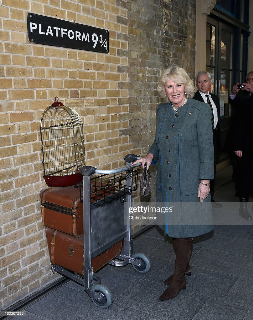 Camilla, Duchess of Cornwall poses on platform 9 3/4 at King's Cross Rail Station during a visit to mark 150 years of London Underground on January 30, 2013 in London, England.