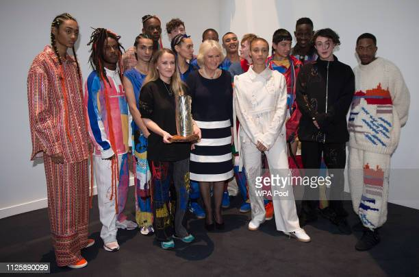Camilla, Duchess Of Cornwall poses with designer Bethany Williams who was awarded the second QEll Award for British Design and her models including...