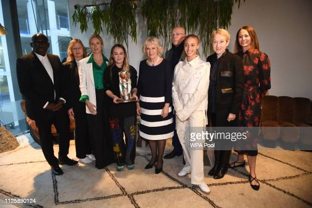 Camilla Duchess Of Cornwall poses with designer Bethany Williams who was awarded the second QEll Award for British Design and her models including...