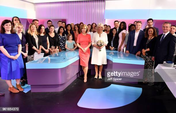 Camilla Duchess of Cornwall poses with journalists including News Anchor Sian Williams and members of the crew as she visits the headquarters of...