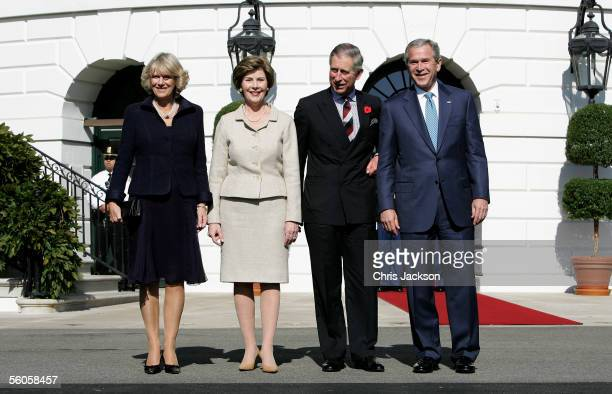 Camilla Duchess of Cornwall poses with Laura Bush Charles Prince of Wales and US President George W Bush during a visit to the White House on the...