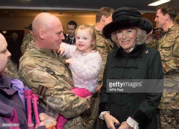 Camilla Duchess of Cornwall poses with Lnc/Cpl Stuart Kay and his daughter Adrian as she visits the 4th Battalion The Rifles at Normandy Barracks on...