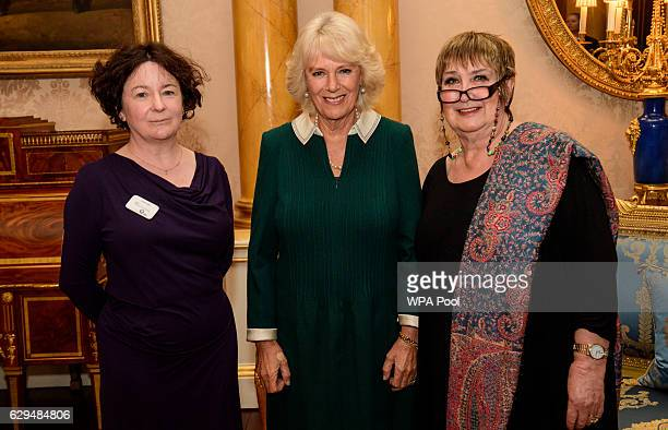 Camilla Duchess of Cornwall poses with presenters Jane Garvey and Jenni Murray as she attends a reception and recording at Buckingham Palace to mark...