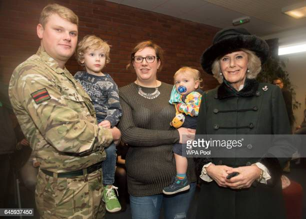 Camilla Duchess of Cornwall poses with Sgt Paul Sapsford and his wife Amanda and sons Charlie and Oscar as she visits the 4th Battalion The Rifles at...