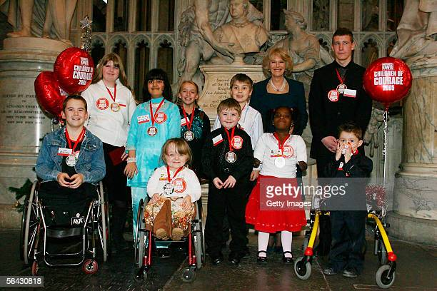 Camilla Duchess of Cornwall poses with the Woman's Own Children of Courage award winners at Westminster Abbey on December 14 2005 in London England...