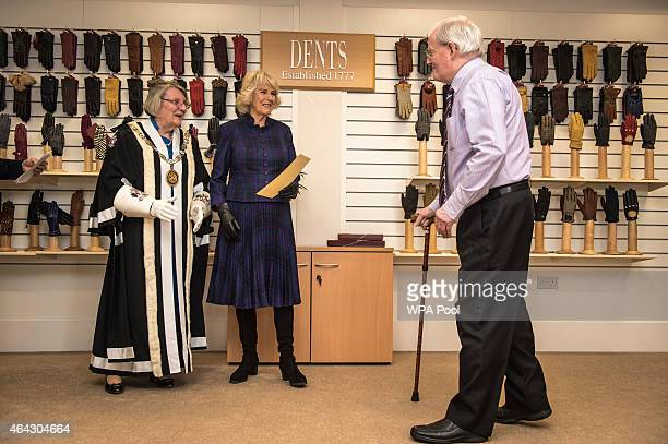 Camilla Duchess of Cornwall presents a long service certificate award to John Cundick for 65 years at Dents factory on February 24 2015 in Warminster...