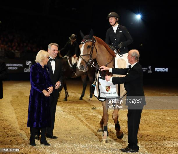 Camilla Duchess of Cornwall presents a trophy to Great Britain's Laura Renwick who won the Cayenne Puissance riding Top Dollar VI Olympia at the...