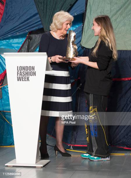 Camilla, Duchess Of Cornwall presents designer Bethany Williams with the second QEll Award for British Design as she visits London Fashion Week at...