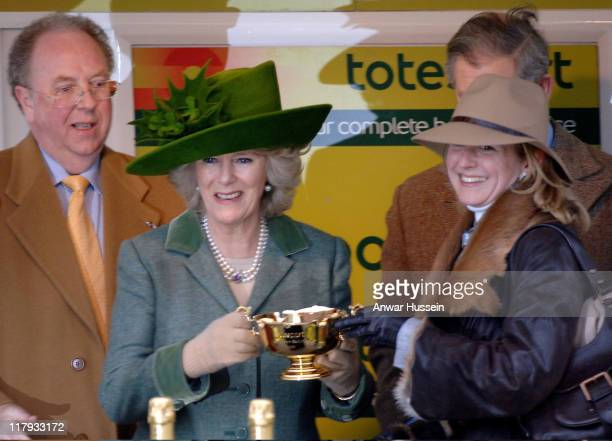 Camilla, Duchess of Cornwall presents the Gold Cup Award to the owner the winning horse War of Attrition at Cheltenham Races on March 17, 2006.