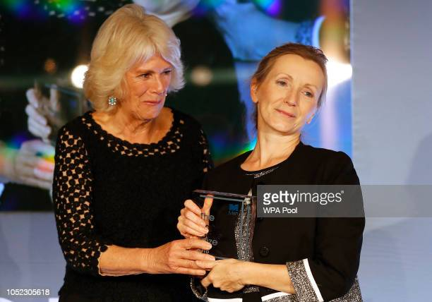 Camilla Duchess of Cornwall presents writer Anna Burns with the Man Booker Prize for Fiction 2018 during the prize's 50th year at the Guildhall on...