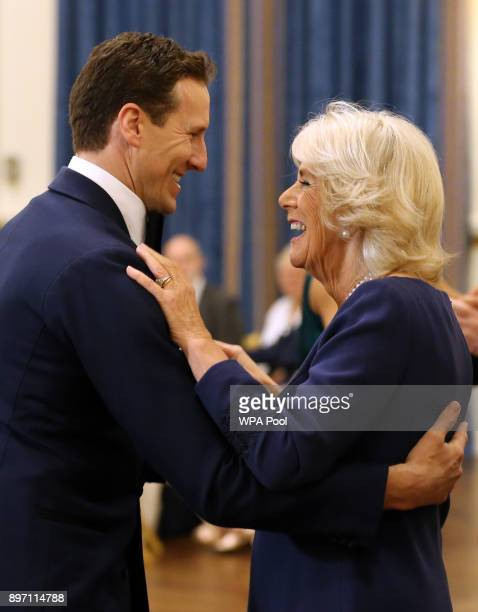 Camilla Duchess of Cornwall President of the National Osteoporosis Society dances with 'Strictly Come Dancing' professional dancer Brendan Cole as...