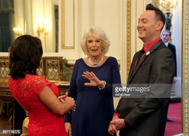 Camilla Duchess of Cornwall President of the National Osteoporosis Society talks to 'Strictly Come Dancing' judges Shirley Ballas and Craig Revel...