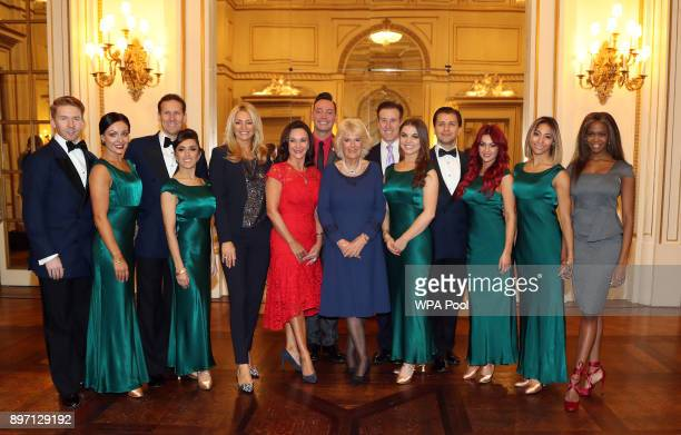 Camilla Duchess of Cornwall President of the National Osteoporosis Society poses with Strictly Come Dancing professional dancers Neil Jones Amy...