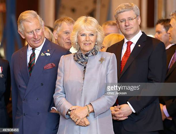 Camilla, Duchess of Cornwall, Prince Charles, Prince of Wales and Prime Minister of Canada Stephen Harper at Stevenson Campus Air Hanger on May 21,...