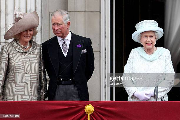 Camilla, Duchess of Cornwall, Prince Charles, Prince of Wales and Queen Elizabeth II waves on the balcony of Buckingham Palace after the service of...