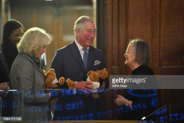 Camilla, Duchess of Cornwall, Prince Charles, Prince of Wales are presented with toys by Lady Hale, President of the Supreme Court during a visit to...